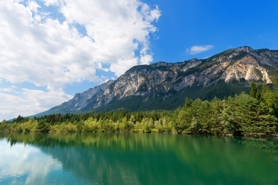 The green Gail River the largest tributary of the Drava River. Carinthia, Austria