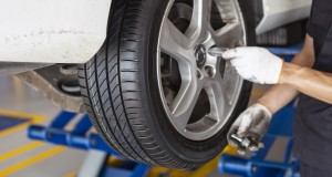 car wheel tire replacement by mechanic in the garage